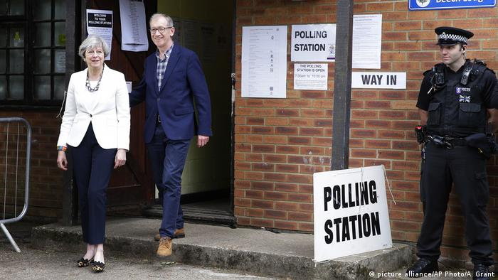Brexit means Brexit. Britain's Prime Minister Theresa May does her own version of Brexit, with her husband Philip after voting in Maidenhead.