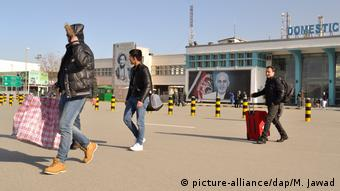 Afghan deportees after their arrival at Kabul