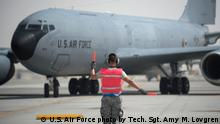 A U.S. Air Force airman with the 379th Expeditionary Aircraft Maintenance Squadron marshals a KC-135 Stratotanker at Al Udeid Air Base, Qatar, May 29, 2017. The KC- 135 Stratotanker Aircraft Commander, Brig. Gen. Darren James, wing commander of the 379th Air Expeditionary Wing, just completed his fini-flight. The fini-flight is a time honored aviation tradition which marks the end of James' flying status as wing commander of the 379th AEW. During his time as wing commander, James flew over 325 hours and 40 sorties. (U.S. Air Force photo by Tech. Sgt. Amy M. Lovgren)