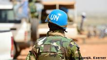 GAO, MALI - MARCH 07: A Bangladeshi United Nations soldier walks by a car during the weekly cattle market on March 7, 2017 in Gao, Mali. Each week locals and Touareg nomads gather at the market to trade their cattle including Camels, Cows, Sheep and clothing. U.N.-led MINUSMA (United Nations Multidimensional Integrated Stabilization Mission) troops are assisting the Malian government in its struggle against rebels that include a Tuareg movement (MNLA) and several Islamic armed groups, among them Al-Qaeda, in the north of Mali. Rebels have conducted a series of terror attacks to destabilize the current government in recent years. The Bundeswehr has committed helicopters and 750 soldiers to the MINUSMA mission as well as 147 soldiers to the EUTM mission (European Trainings Mission Mali) to train government troops. In mid-April the Bundeswehr is to deploy four «Tiger«combat helicopter. (Photo by Alexander Koerner/Getty Images)