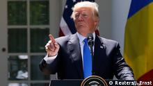 09.06.2017 U.S. President Donald Trump (R) holds a joint news conference with Romanian President Klaus Iohannis in the Rose Garden at the White House in Washington, U.S. June 9, 2017. REUTERS/Jonathan Ernst