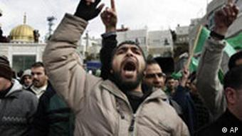 Palestinian Hamas supporters chant slogans
