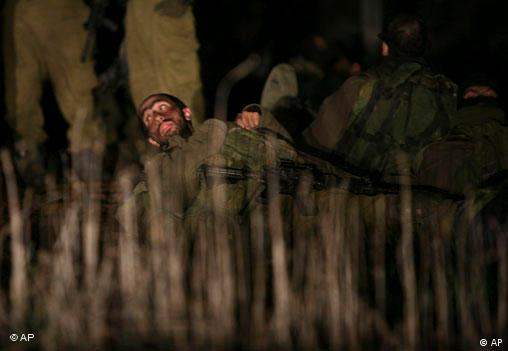 An Israel soldier lays on the ground before leaving Israel for the northern Gaza Strip