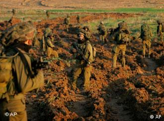 Israeli infantry soldiers enter Gaza from Israel on a combat mission on Sunday, Jan. 4