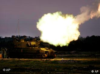 Israeli army artillery being fired towards targets in the southern Gaza Strip
