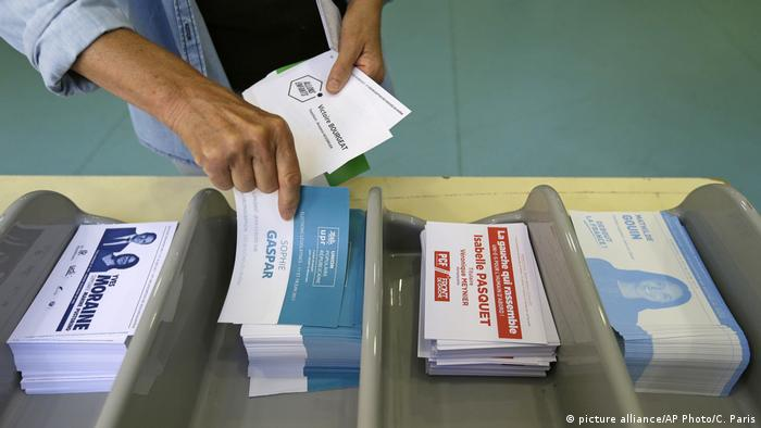 A voter collect ballots ahead of voting
