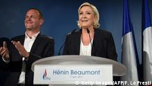 11.06.2017 +++ France's far-right National Front (FN) leader and parliamentary candidate Marine Le Pen (R) gives a speech next to Henin-Beaumont Mayor Steeve Briois (L) after polls closed for the first round of the French legislative elections in Paris, on June 11, 2017. The deputy chairman of French far-right leader Marine Le Pen's National Front (FN) said the party was disappointed by its result in June 11 first-round parliamentary vote. / AFP PHOTO / FRANCOIS LO PRESTI (Photo credit should read FRANCOIS LO PRESTI/AFP/Getty Images)