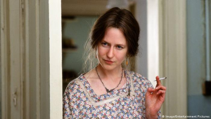 Film still from The Hours with Nicole Kidman smoking a cigarette standing in a door way (Imago/Entertainment Pictures)