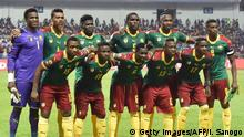 February 5, 2017*** Cameroon's squad (back L-R) goalkeeper Fabrice Ondoa, defender Adolphe Teikeu, midfielder Robert Ndip Tambe, defender Michael Ngadeu-Ngadjui, forward Jacques Zoua, forward Benjamin Moukandjo, (L-R) midfielder Sebastien Siani, defender Collins Fai, defender Ambroise Oyongo, midfielder Christian Bassogog and midfielder Arnaud Sutchuin-Djoum pose for a group photo prior to the start of the 2017 Africa Cup of Nations final football match between Egypt and Cameroon at the Stade de l'Amitie Sino-Gabonaise in Libreville on February 5, 2017. / AFP / ISSOUF SANOGO (Photo credit should read ISSOUF SANOGO/AFP/Getty Images)