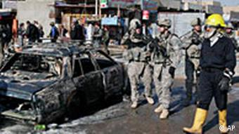 US troops inspect the site of a blast in Abu Dshir in Baghdad, Iraq