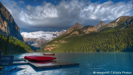 Shore of Lake Louise at sunrise with canoes and Canadian Rocky Mountains Banff National Park Alberta (Imago/All Canada Photos)