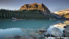 First light on Lake Louise with Fairview Mountain and the Victoria Glacier in the Canadian Rockies