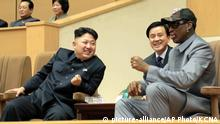 In this Jan. 8, 2014 photo provided by the North Korean government, North Korean leader Kim Jong Un, left, talks with former NBA player Dennis Rodman, right, as they watch an exhibition basketball game at an indoor stadium in Pyongyang. North Korea is expecting another visit by former NBA bad boy Rodman on Tuesday, June 13, 2017, in what would be his first to the country since President Donald Trump took office. Independent journalists were not given access to cover the event depicted in this photo. (Korean Central News Agency/Korea News Service via AP)  
