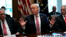 12.06.2017+++ Secretary of State Rex Tillerson (L) and Secretary of Defense James Mattis (R) flank U.S. President Donald Trump as he meets with his Cabinet at the White House in Washington, U.S., June 12, 2017. REUTERS/Kevin Lamarque