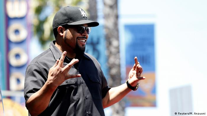 Rapper Ice Cube gestures before unveiling his star on the Hollywood Walk of Fame in Los Angeles, California