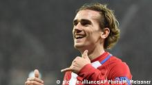 FILE - This is a Tuesday, Feb. 21, 2017 file photo, of Atletico Madrid's Antoine Griezmann as he celebrates after scoring his side's second goal during the Champions League round of 16 first leg soccer match between Bayer Leverkusen and Atletico Madrid in Leverkusen, Germany. Atletico Madrid's transfer ban was upheld by the Court of Arbitration for Sport on Thursday June 1, 2017, harming Manchester United's hopes of signing Antoine Griezmann. (AP Photo/Martin Meissner/ File) |