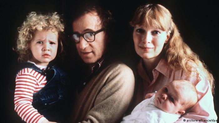 Woody Allen Mia Farrow and two of their children: a young girl and a baby