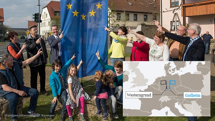 Pessoas em Gadheim com uma bandeira da UE