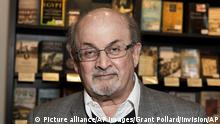 Author Salman Rushdie poses for photographers at a signing for his new book 'Home', in London, Tuesday, June 6, 2017. (Photo by Grant Pollard/Invision/AP)  