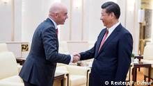 14.06.2017 *** China's President Xi Jinping (R) meets FIFA President Gianni Infantino at the Great Hall of the People in Beijing, China June 14, 2017. REUTERS/Fred Dufour/Pool