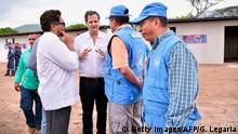21.03.2017 *** Colombian High Peace Commissioner for Peace Sergio Jaramillo (2) talks with FARC commanders Ivan Marquez (L) and UN representatives during a visit to the Transitional Standardization Zone in Pondores, La Guajira department, Colombia on March 21, 2017. Colombian High Peace Commissioner for Peace Sergio Jaramillo, UN representatives and members of the Tripartite Mechanism for Monitoring and Verifying the Cessation of Fire and Bilateral and Definitive Hostilities and Detachment of Weapons visit the FARC's disarmament zone. Colombia's FARC rebels started a historic disarmament process to end Latin America's last major armed conflict. / AFP PHOTO / GUILLERMO LEGARIA (Photo credit should read GUILLERMO LEGARIA/AFP/Getty Images)