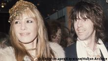 Anita Pallenberg, Italian actress and model, with Keith Richards, British guitarist with The Rolling Stones, attending the premiere of 'Performance', circa 1970. Pallenberg co-wrote the film, which stars Richards' Rolling Stones bandmate, Mick Jagger. (Photo by Keystone/Hulton Archive/Getty Images)