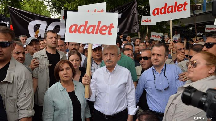 Turkish opposition leader Kemal Kilicdaroglu holds a sign reading Justice at a protest in Ankara