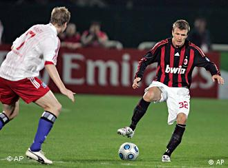 Milan's David Beckham, right, controls the ball as Marcell Jansen of Hamburg tries to close him down during the friendly soccer match between AC Milan and Hamburg SV in Dubai, Jan. 6
