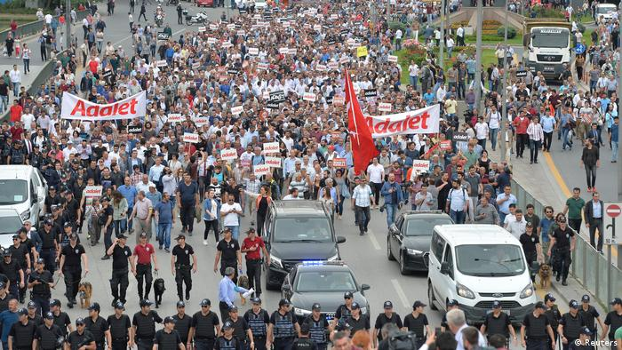 Protesters march on the street in Ankara