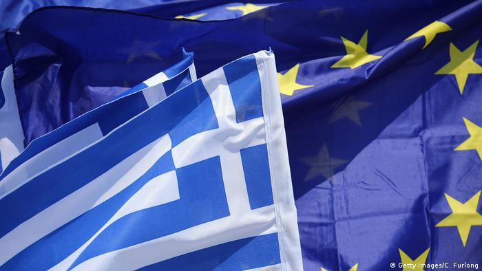 An EU flag and flags of Greece flutter on the wind (Getty Images/C. Furlong)