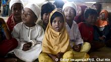 This photo taken on May 19, 2017 shows children from theOrang Rimba tribe -- whose name translates as jungle people, who have been converted to Islam and given up their nomadic ways, wearing Islamic skullcaps and hijabs as they gather to recite the Koran, in the Batang Hari district of Jambi province. Indonesia is home to an estimated 70 million tribespeople, out of a population of 255 million, from the heavily tattooed Dayaks of Borneo island to the Mentawai who are famed for sharpening their teeth as they believe it makes them more beautiful. / AFP PHOTO / GOH CHAI HIN / TO GO WITH Indonesia-indigenous-Islam-environment, FEATURE by Kiki Siregar (Photo credit should read GOH CHAI HIN/AFP/Getty Images)