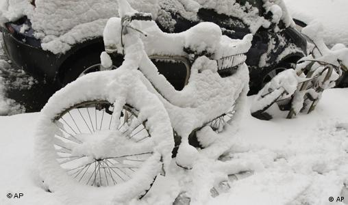 Snow covered bicycle in Milan