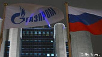 The building of the Gazprom gas mammoth in Moscow, with Gazprom and Russian flags waving