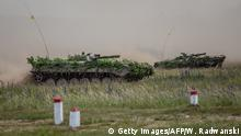 16.06.2017*****CORRECTION - NATO troops take part in Saber Strike military exercises, on June 16, 2017 in Orzysz. / AFP PHOTO / Wojtek RADWANSKI / The erroneous mention[s] appearing in the metadata of this photo by Wojtek RADWANSKI has been modified in AFP systems in the following manner: [--NATO troops take part in Saber Strike military exercises, on June 16, 2017 in Orzysz.-] instead of [--Germany's Philipp Kohlschreiber returns the ball to France's Lucas Pouille in their quarterfinal match at the ATP Cup tennis tournament in Stuttgart, southwestern Germany, on June 16, 2017. -]. Please immediately remove the erroneous mention[s] from all your online services and delete it (them) from your servers. If you have been authorized by AFP to distribute it (them) to third parties, please ensure that the same actions are carried out by them. Failure to promptly comply with these instructions will entail liability on your part for any continued or post notification usage. Therefore we thank you very much for all your attention and prompt action. We are sorry for the inconvenience this notification may cause and remain at your disposal for any further information you may require. (Photo credit should read WOJTEK RADWANSKI/AFP/Getty Images)