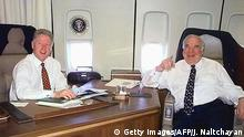 US President Bill Clinton (L) and German Chancellor Helmut Kohl share a joke 14 May aboard Air Force One while en route to Frankfurt, Germany. Clinton is scheduled to arrive in Birmingham, England, later 14 May, where he will attend the G8 Summit. (ELECTRONIC IMAGE) (Photo credit should read JOYCE NALTCHAYAN/AFP/Getty Images)