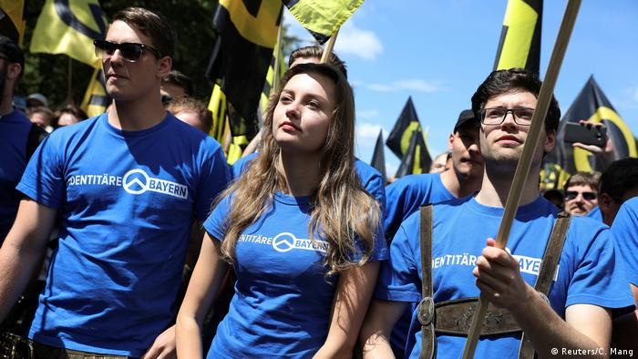 Protesters take part in a demonstration of the far-right Identitarian Movement