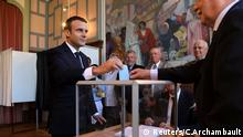 French President Emmanuel Macron casts his ballot as he votes at a polling station in the second round parliamentary elections in Le Touquet, France, June 18, 2017. REUTERS/Christophe Archambault/Pool