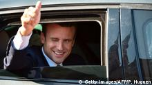 French President Emmanuel Macron gestures from his car as he leaves to vote in Le Touquet, northern France, during the second round of the French parliamentary elections (elections legislatives in French), on June 18, 2017. / AFP PHOTO / Philippe HUGUEN (Photo credit should read PHILIPPE HUGUEN/AFP/Getty Images)