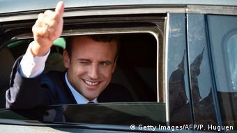 Emmanuel Macron in a car