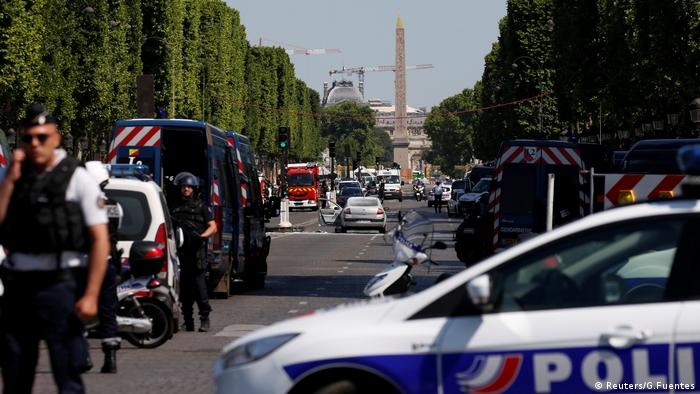 French police secure the area on the Champs Elysees avenue after an incident in Paris (Reuters/G.Fuentes)