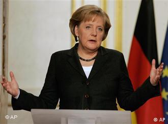 German Chancellor Angela Merkel gestures during a joint press conference with French President Nicolas Sarkozy