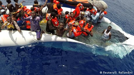 A boat with African refugees being saved in Libyan waters
