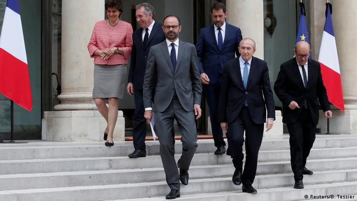 French Prime Minister Edouard Philippe, Minister of State for Relations with Parliament and government spokesperson Christophe Castaner, Minister of the Interior Gerard Collomb and Minister of Europe and Foreign Affairs Jean-Yves Le Drian walk towards journalists at the Elysee Palace (Reuters/B. Tessier)