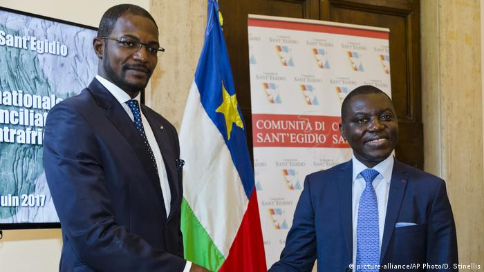 Central African Foreign Minister Charles Armel Doubane (right) and rebel leader Armel Mingatoloum Sayo (left) marked the momentous occassion by shaking hands