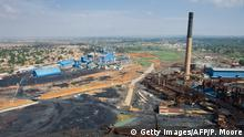 A picture taken on December 1, 2011 shows the STL (Soci?t? pour le traitement du terril de Lubumbashi or Company for the treatment of the slap heap of Lubumbashi) processing plant (L) and the Gecamines plant, now largely unused (R) in Lubumbashi. Lumubashi is the heart of the mineral rich Katanga province in the Democratic Republic of the Congo, a major producer of cobalt and copper, which is extracted from this slag heap by the company STL. AFP PHOTO / PHIL MOORE (Photo credit should read PHIL MOORE/AFP/Getty Images)