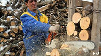 A man cuts firewood