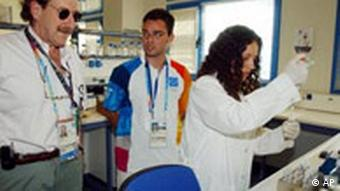International Olympic Committee medical director Patrick Schamasch, left, visits the Doping Control Laboratory in Athens, on Monday, Aug. 2, 2004. Some 500 people will be hired to conduct doping tests during the Athens Olympics. (AP Photo/Thanassis Stavrakis, Pool)