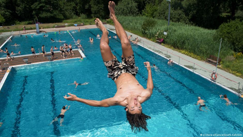 Naked outside pool