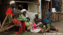 South Sudanese refugee women living in Nguenyyiel Refugee camp prepare vegetables for cooking near Gambella, Ethiopia June 19, 2017. REUTERS/David Lewis