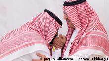 In this Wednesday, June 21 , 2017 photo released by Al-Ekhbariya, Mohammed bin Salman, newly appointed as crown prince, left, kisses the hand of Prince Mohammed bin Nayef at royal palace in Mecca, Saudi Arabia. Saudi Arabia's King Salman on Wednesday appointed his 31-year-old son Mohammed bin Salman as crown prince, placing him first-in-line to the throne and removing the country's counterterrorism czar and a figure well-known to Washington from the line of succession. (Al-Ekhbariya via AP) |